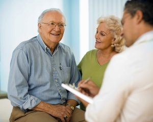 Patient consulting with audiologist