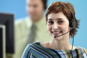 Photo of live chat agent smiling