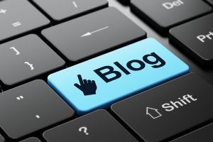 Computer keyboard with Mouse Cursor icon and word Blog