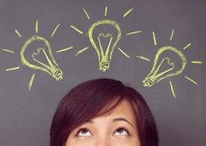 Picture of person with light bulbs over their head