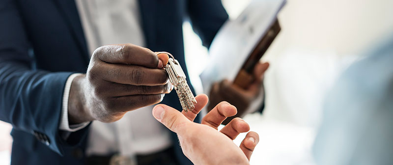 Passing the keys to a sold medical practice.