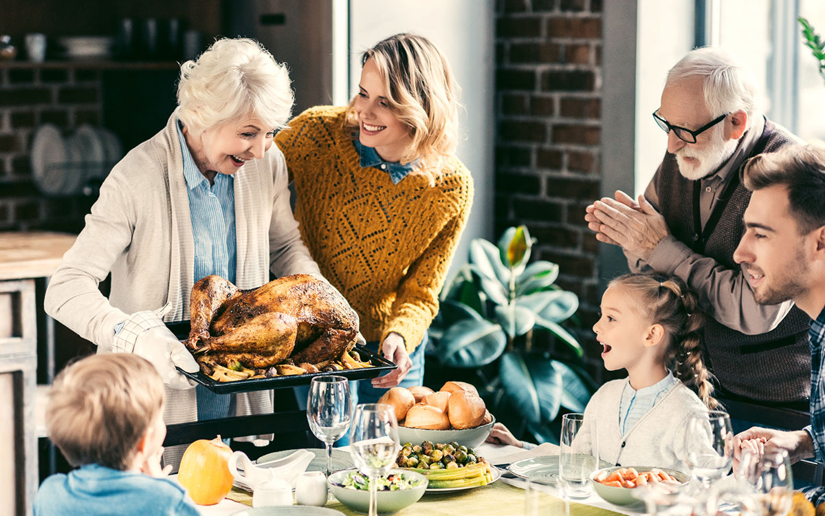 Hearing Aid Marketing for a family enjoying Thanksgiving dinner.