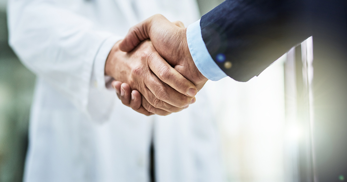 Shaking hands and trusting the practice because of positive patient reviews.