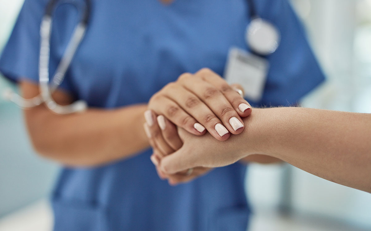 Hand of a patient clasped to a doctors. Happy patients.