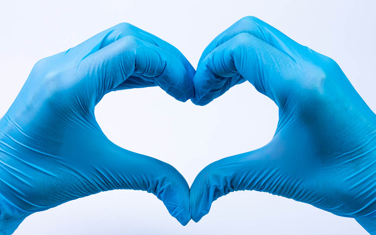 Doctor's hands making heart shape. COVID-19 - How Practices Are Adapting
